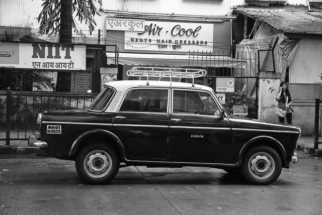 This is an endangered species of cabs in Mumbai. The 1970's Fiat taxies are under the scanner with the traffic department and are steadily being replaced by Cool cabs. Strange that this one is parked in front of a hair dressers parlor also dating back to the 70's!