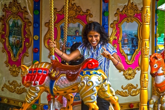 I like to watch people. The merry go round is essentially for toddlers or as in this case for those who want to revisit their days as one.