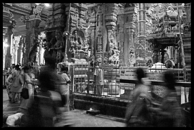 The temple's four main towers and entrances each face one of the four directions (north, east, south, and west). The tallest one, the southern tower, stretches nearly 170 feet (52 meters) high! Inside, there are two main shrines -- one dedicated to Goddess Meenakshi (also known as Goddess Parvati) and the other to her husband Lord Shiva. Meenakshi's shrine, which is green, houses a piece of emerald that was brought back from Sri Lanka in the 10th century.