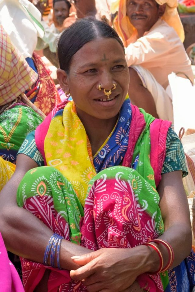 The bindi on her forehead is a permanent tattoo, a symbol that helps identify her tribe.