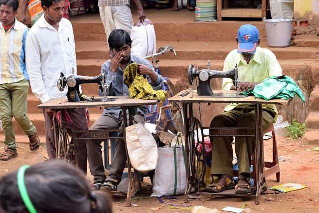 On the spot tailoring is one of the features of this market. Stitching blouses, shirts and bags at breakneck speed made for this picture.