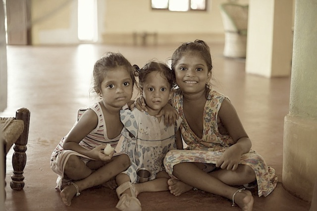 The girl in the middle is an intelligent one except that she has multiple deformities. In the company of normal kids she has learnt how to use her one arm and leg to accomplish many a task.