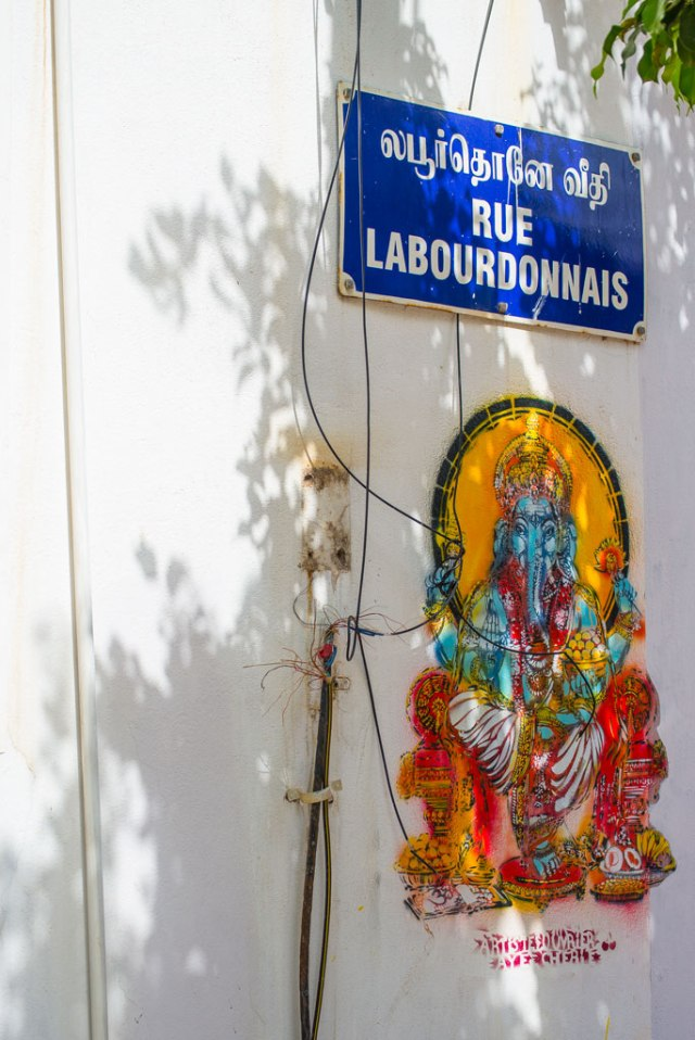 Street Graffiti is subtle and detailed. The French street sign has an Indian twist. Any guesses why Ganesha is so loved the world over?