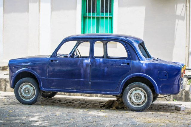 Pondicherry or Puducherry is a town that loves it's past. As seen in this picture of an old Fiat much celebrated in the 1950's. Being lovingly brought back to its old glory at a mechanics or maybe a DIY project of the owners.